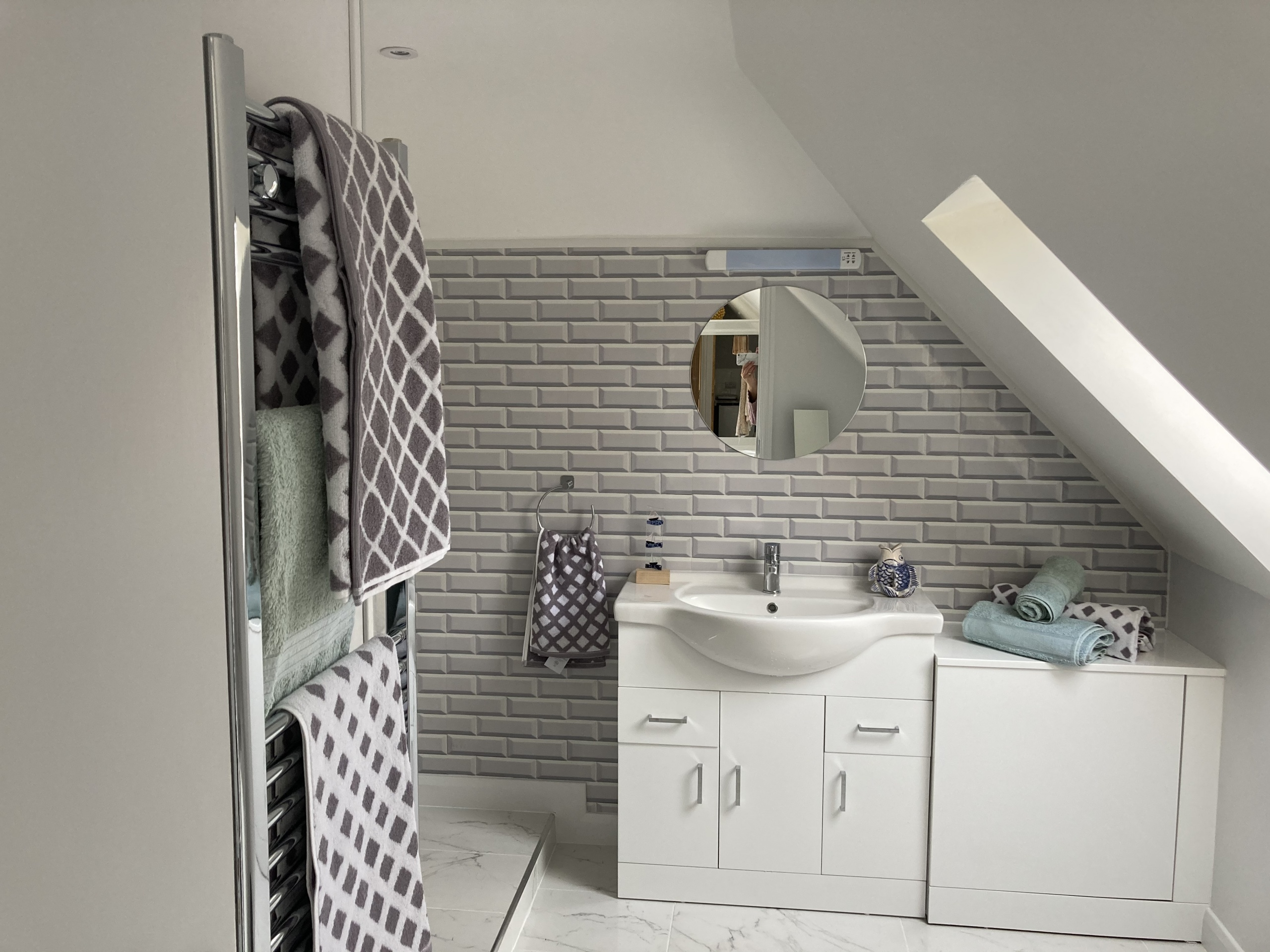 There is so much space in this bathroom with a his and hers vanity unit
